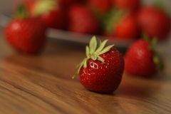Strawberry. Single strawberry jn the table, close-up royalty free stock photography