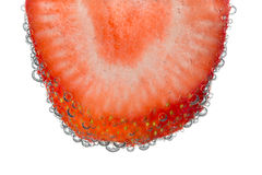 Strawberry Slice in Clear Fizzy Water Bubble Background Stock Photos