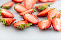 Strawberry slice on cutting boards. Strawberry slice on the white cutting boards Stock Photos