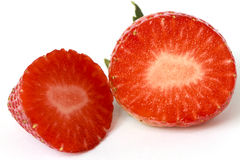 Strawberry slice. Over white background Royalty Free Stock Images