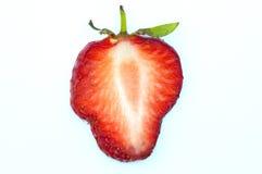 Strawberry slice on white. Fresh strawberry slice on white with stem Royalty Free Stock Image