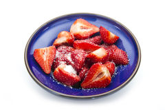 Strawberry. Sliced strawberries with sugar isolated on white background Stock Photos