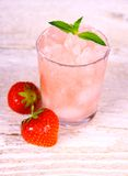 Strawberry slush in glass with fruits and mint. Soft focus Stock Photos