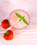 Strawberry slush in glass with fruits and mint, soft focus Stock Photo