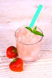 Strawberry slush in glass with straw and mint Stock Photography