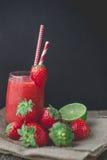 Strawberry Slush, Strawberry Smoothie on Wooden Background, Summber Drink, Fresh Beve. Strawberry Slush on Wooden Background, Summber Drink, Fresh Beverage stock image