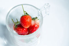 Strawberry in a small clear glass Royalty Free Stock Photos