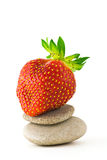 Strawberry on Smooth Stones Stock Photos