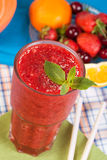 Strawberry smoothie. On a colorful background Stock Image