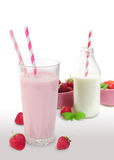 Strawberry smoothie. In glass, bottle of milk and strawberries in the background Stock Photography