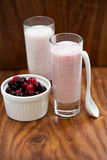 Strawberry smoothie and berries in a bowl Royalty Free Stock Images