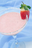 Strawberry smoothie in cocktail glass vertical selective focus Royalty Free Stock Images