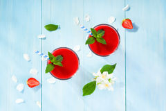 Strawberry smoothie and flower petals Royalty Free Stock Image
