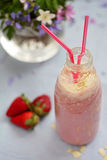 Strawberry smoothie freshly made in a jar with a lined straw, fo Stock Image