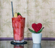 Strawberry smoothie with heart on the pot, Valentine day Stock Image