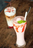 Strawberry smoothie with iced strawberry latte Stock Image