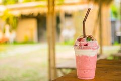Strawberry smoothie Located on a table with a beautiful orange l royalty free stock photo