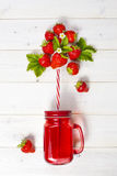 Strawberry smoothie in mason jar with straw Stock Images