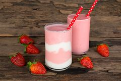 Strawberry smoothies colorful fruit juice beverage healthy the taste yummy In glass drink episode morning on wooden background. Strawberry smoothie or milkshake royalty free stock image