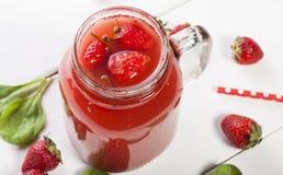 Strawberry smoothie or milkshake in a jar on white background. Stock Photo