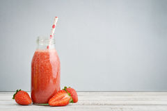 Strawberry  smoothie in retro bottle Stock Image