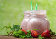 Strawberry smoothie with straw Stock Images