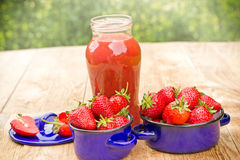 Strawberry smoothie on a table Royalty Free Stock Images