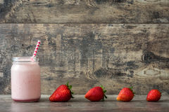 Strawberry smoothie on wooden Royalty Free Stock Photography