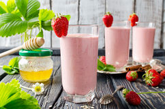 Strawberry smoothie on a wooden table Stock Photos