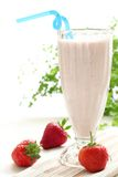Strawberry smoothies. On the table royalty free stock image