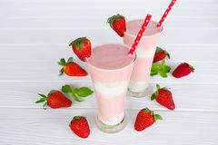 Strawberry smoothies yogurt, juice and strawberry fruit for breakfast in the morning on white wood background. royalty free stock photos
