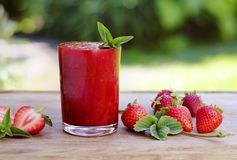 Strawberry smoothies decorated with mint leaves7 stock photo