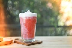 Strawberry smoothies red colorful fruit juice. Decoration with milk foam royalty free stock images
