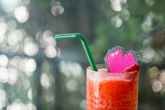 Strawberry smoothies red colorful fruit juice. Woth heart toy decoration on top stock photography
