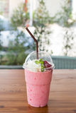 Strawberry smoothies summer strawberry with leaf of mint on wooden table. Stock Photography