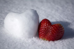 Strawberry and Snow Heart Shape on White Snow Background. Lovely strawberry and snow heart shape on white snow background Stock Image