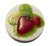Strawberry Soap. Natural handmade soap round with bright strawberries Stock Images