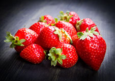 Strawberry. Some strawberry on wood background Royalty Free Stock Photography