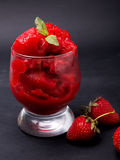 Strawberry sorbet. In a glass on the black bakrground Royalty Free Stock Image