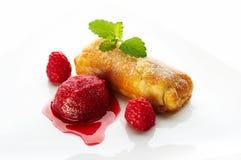 Strawberry sorbetto. On white plate Royalty Free Stock Photo