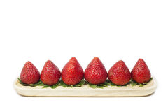 Strawberry sorted on wooden dish in white background Royalty Free Stock Photos
