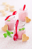 Strawberry soup. Delicious strawberry, mint and yogurt soup in glass jars and shape heart cookies, selective focus Stock Photography