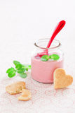 Strawberry soup. Delicious strawberry, mint and yogurt soup in glass jars and shape heart cookies, selective focus Royalty Free Stock Photo