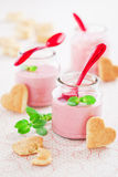 Strawberry soup. Delicious strawberry, mint and yogurt soup in glass jars and shape heart cookies, selective focus Royalty Free Stock Photos
