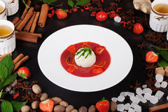 Strawberry soup with ice cream, cinnamon, tea, still life, table Royalty Free Stock Image