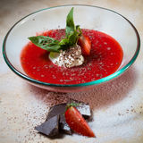 Strawberry soup with ice cream and mint on a plate Stock Images