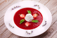 Strawberry soup with ice cream and mint. Stock Photo