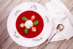 Strawberry soup with ice cream and mint. Stock Photography