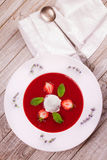 Strawberry soup with ice cream and mint. Royalty Free Stock Photography