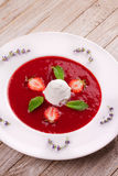 Strawberry soup with ice cream and mint. Royalty Free Stock Image
